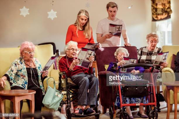 choir service amongst the elderly - choir stock pictures, royalty-free photos & images