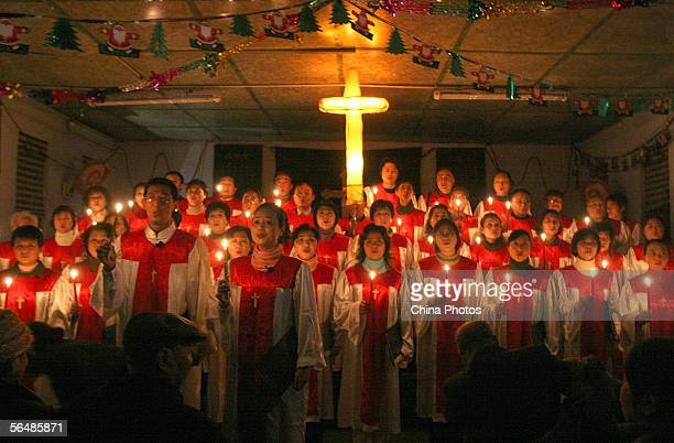Choir sing during a Christmas Eve mass at a church on December 24 2005 in Chengdu of Sichuan Province China Christmas is celebrated across China as...