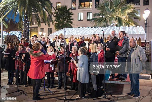 Choir singing carols in Christmas market