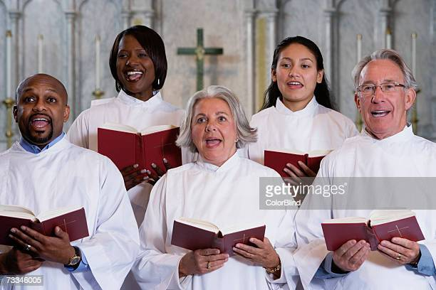 choir singing in church - choir stock pictures, royalty-free photos & images