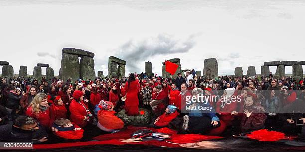 A choir sings as druids pagans and revellers gather in the centre of Stonehenge hoping to see the sun rise as they take part in a winter solstice...