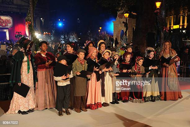 a choir sings christmas carols during for the world film premiere of disneys a christmas - Christmas Carol 2009