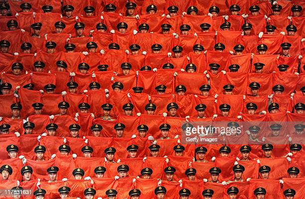 A choir sings 'red songs' on stage to mark the 90th Anniversary Of The Communist Party Of China on June 30 2011 in Binzhou Shandong Province of China...