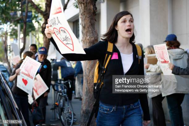 Choir teacher Courtney Lindl of A.P. Giannini Middle School protests layoffs with other teachers and parents of the San Francisco Unified school...