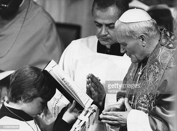 A choirboy holds a text for Pope John Paul II who is conducting a service for the sick disabled and dying at Southwark Cathedral London on the first...