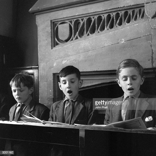 Choirboys singing during a practice session at St George's School in Windsor Twenty of the school's eighty pupils are choristers of the Queen's Free...