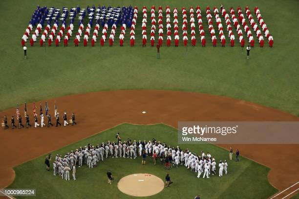 Choirs perform the national anthem before the 89th MLB AllStar Game presented by Mastercard at Nationals Park on July 17 2018 in Washington DC