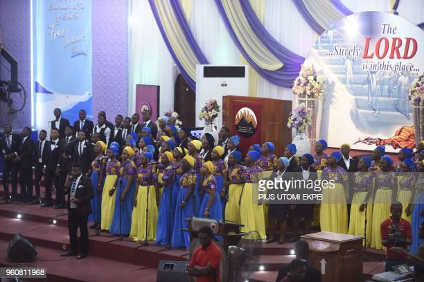 Choirs sing as players and officials of Mountain of Fire and Miracles Ministries football club sing along with other worshippers in the church at the...