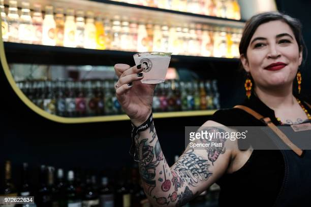 Chokie Tom a brand ambassador for Thomas Henry holds up a drink at Bar Convent Brooklyn an international bar beverage trade show at the Brooklyn Expo...