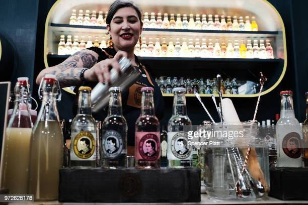 Chokie Tom a brand ambassador for Thomas Henry mixes a drink at Bar Convent Brooklyn an international bar and beverage trade show at the Brooklyn...