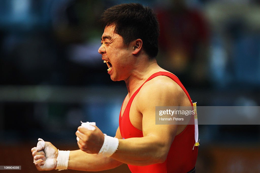 Chol Kum Pang of Korea celebrates winning the Men's Weightlifting 77kg competition during day four of the 16th Asian Games Guangzhou 2010 at Dongguan Gymnasium on November 16, 2010 in Guangzhou, China.