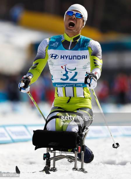 Chol You Ma of North Korea reacts after competing in the Men's Cross Country 11km Sprint Sitting event at Alpensia Biathlon Centre during day five of...