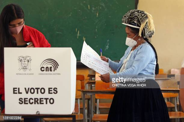 """Chola cuencana"""" -peasant woman of Cuenca- casts her vote at the Fausto Molina school during the 2021 Presidential Elections, in Cuenca, Ecuador, on..."""