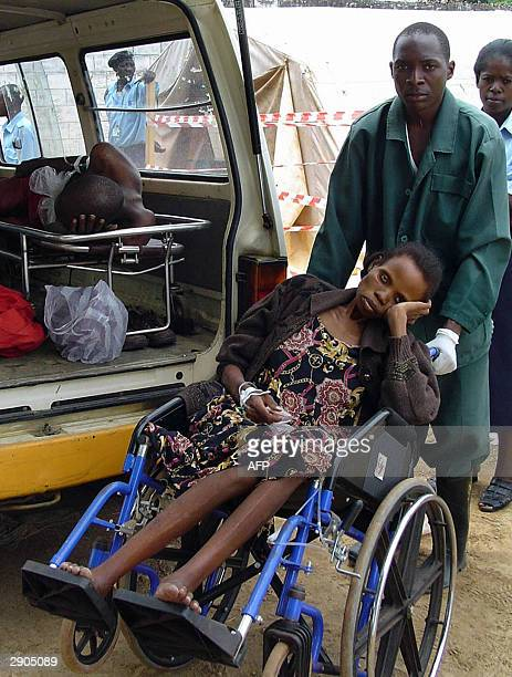 A cholera patient arrives at Matero Cholera centre in Lusaka 27 January 2004 Over 50 people have died and over 400 have been hospitalised after a...