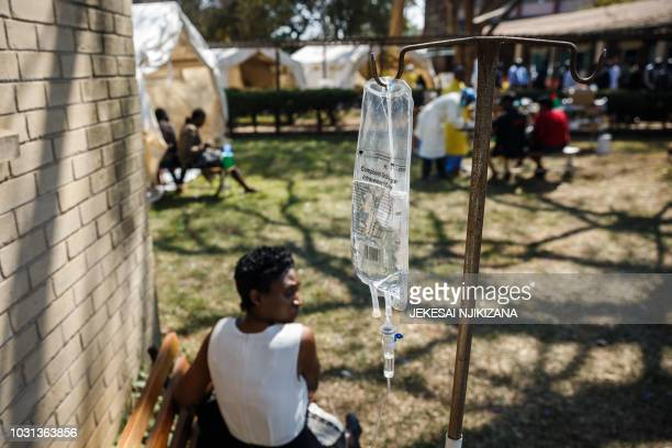 A cholera patient waits for treatment during a visit of Zimbabwe Minister of Health at the cholera treatment centre of the Beatrice Infectious...