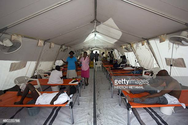 Cholera patients are treated at the MSF Center for Emergency Care in the Martissan area of PortauPrince on December 9 2014 MSF currently has four...