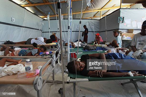 Cholera patients lay on cots as they are treated for cholera in a International Red Cross treatment facility in the slum neighborhood of Cite Soleil...