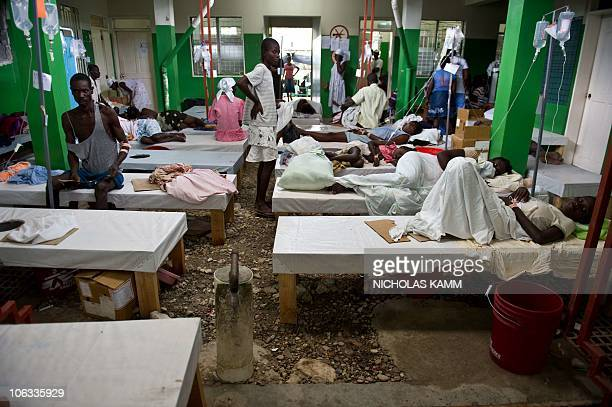 Cholera patients rest in a ward at the Charles Colimon hospital in Petite Riviere on the Artibonite river believed to be the source of Haiti's...