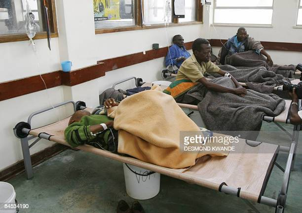Cholera patients wait for treatment at the Budiriro Polyclinic in Harare on January 29 2009 At least 3000 people have died of cholera across the...