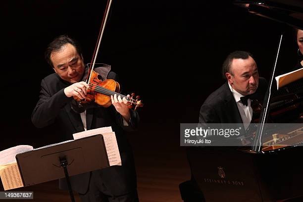 ChoLiang Lin left and Jon Kimura Parker performing John Harbison's Sonata No 1 for Violin and Piano with the Chamber Music Society at Alice Tully...