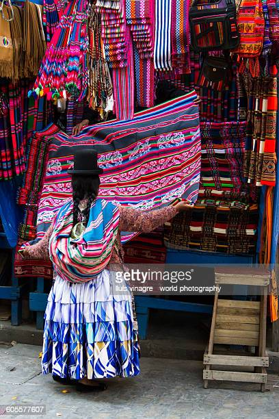 Cholita buying aguayos