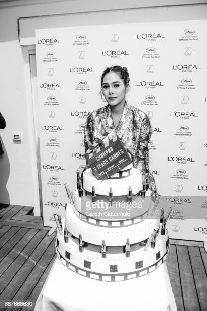 Chompoo Araya celebrates her 5th year anniversary with L'Oreal during the Cannes film festival on May 21 2017 in Cannes France