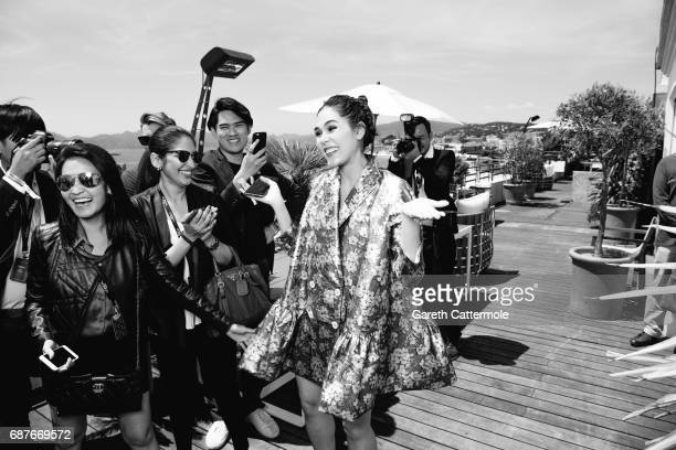Chompoo Araya is photographed at the L'Oreal Terrace during the Cannes film festival on May 21 2017 in Cannes France