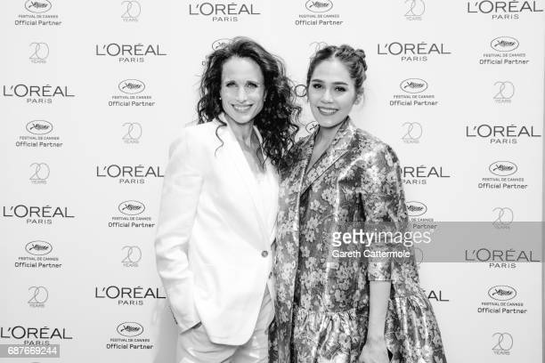Chompoo Araya photographed with Andie MacDowell at the L'Oreal Terrace during the Cannes film festival on May 21 2017 in Cannes France