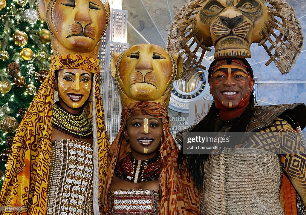 Chondra La-Tease Profit, Lindiwe Diamini and Alton Fitzgerald White White attends the Lighting Ceremony Honoring The 15th Anniversary Of Broadway's 'The Lion King' at The Empire State Building on December 4, 2012 in New York City.