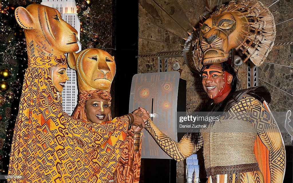 Chondra La-Tease Profit, Lindiwe Diamini and Alton Fitzgerald White attend the lighting ceremony honoring the 15th anniversary of Broadway's 'The Lion King' at the Empire State Building on December 4, 2012 in New York City.