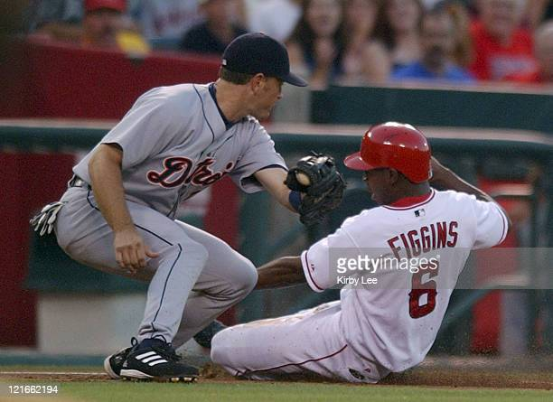 Chone Figgins of the Anaheim Angels slides into third base beneath tag of Shane Halter of the Detroit Tigers. The Angels defeated the Tigers, 3-1