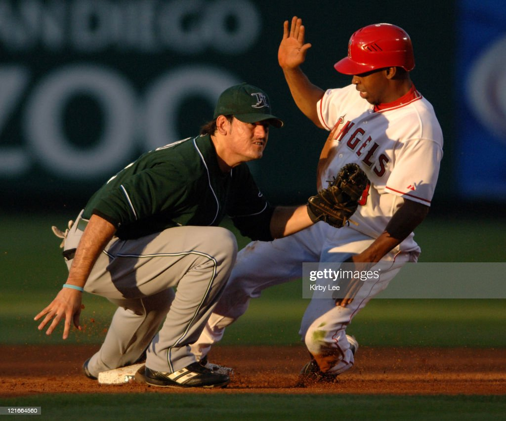 Chone Figgins of the Los Angeles Angels of Anaheim beats tag of Jorge Cantu of the Tampa Bay Rays after advancing to second base on a wild pitch in the first inning of 4-0 victory over the Tampa Bay Devil Rays at Angel Stadiuim in Anahiem, Calif. on Friday, July 14, 2006.