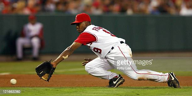Chone Figgins of the Los Angeles Angels of Anaheim dives for a ground ball during 63 loss to the Seattle Mariners at Angel Stadium in Anaheim Calif...
