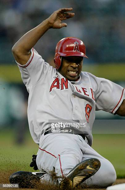 Chone Figgins of the Los Angeles Angels slides into third base on a fielder's choice in the first inning against the Seattle Mariners September 12...