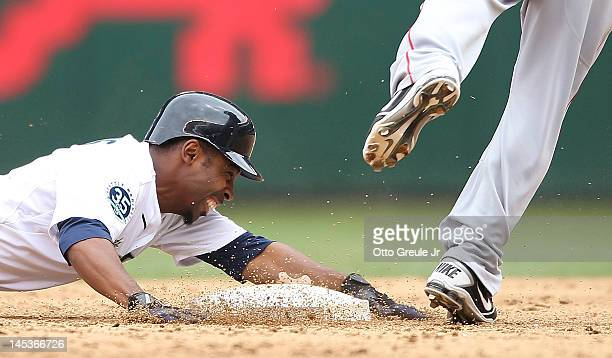 Chone Figgins of the Seattle Mariners grimmaces after being put out at second base on a double play against the Los Angeles Angels of Anaheim at...