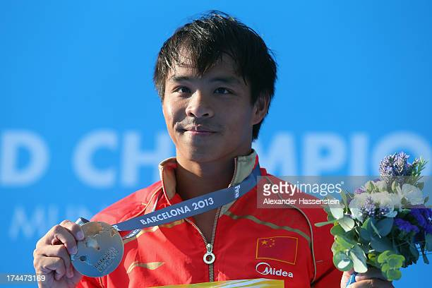 Chong He of China celebrates with the gold medal after the Men's 3m Springboard Diving Final on day seven of the 15th FINA World Championships at...