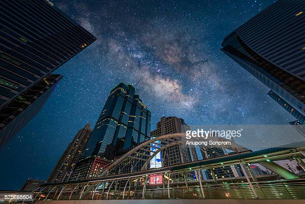 Chong Nonsi Junction with surreal milky way and stars at Bangkok,Thailand
