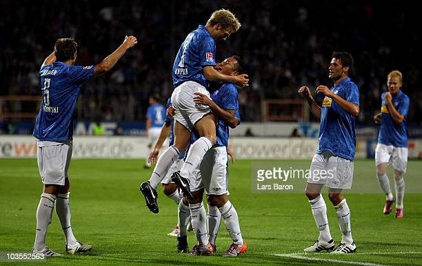 Chong Tese of Bochum celebrates with team mate Bjoern Kopplin after scoring his teams second goal during the Second Bundesliga match between VfL...