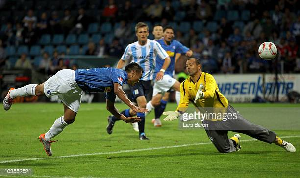 Chong Tese of Bochum heads his teams second goal past goalkeeper Gabor Kiraly of Muenchen during the Second Bundesliga match between VfL Bochum and...