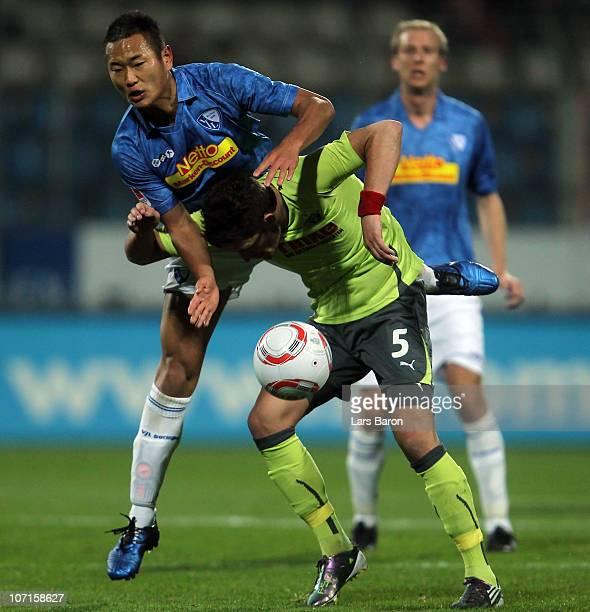 Chong Tese of Bochum jumps over Enis Alushi of Paderborn during the Second Bundesliga match between VfL Bochum and SC Paderborn at Rewirpower Stadium...
