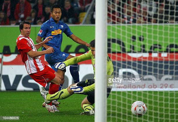 Chong Tese of Bochum scores his teams first goal past Christian Weber and goalkeeper Michael Melka of Duesseldorf during the Second Bundesliga match...