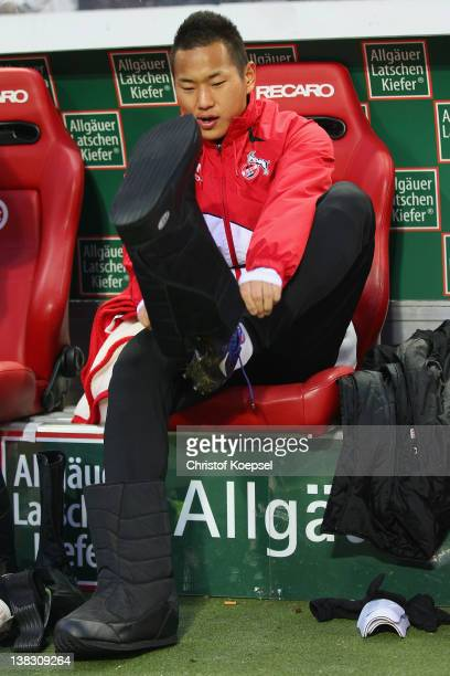 Chong Tese of Koeln puts on boots on the bench during the Bundesliga match between 1. FC Kaiserslautern and 1. FC Koeln at Fritz-Walter-Stadium on...
