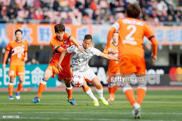 Chong Tese of Shimizu SPulse and Song Ju Hun of Albirex Niigata compete for the ball during the JLeague J1 match between Albirex Niigata and Shimizu...