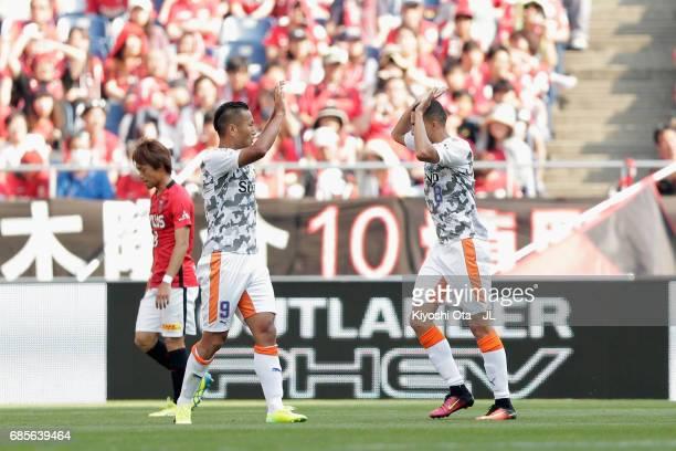 Chong Tese of Shimizu SPulse celebrates scoring his side's first goal with his team mate Tiago Alves during the JLeague J1 match between Urawa Red...