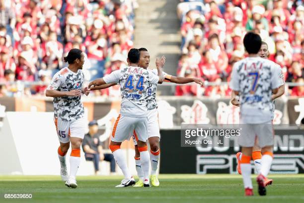 Chong Tese of Shimizu SPulse celebrates scoring his side's first goal with his team mates during the JLeague J1 match between Urawa Red Diamonds and...