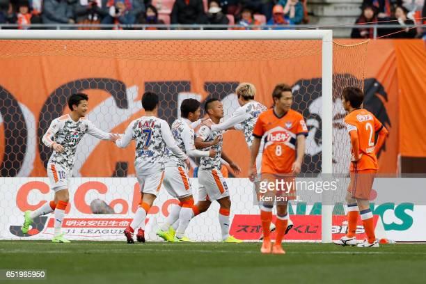 Chong Tese of Shimizu SPulse celebrates scoring the opening goal with his team mates during the JLeague J1 match between Albirex Niigata and Shimizu...