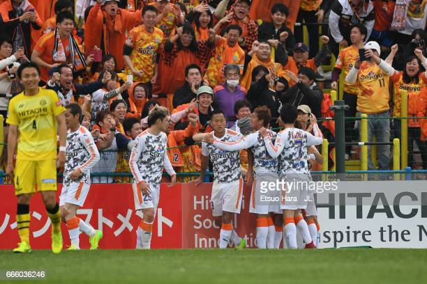 Chong Tese of Shimizu SPulse celebrates scoring the opening goal with his team mates in front of supporters during the JLeague J1 match between...