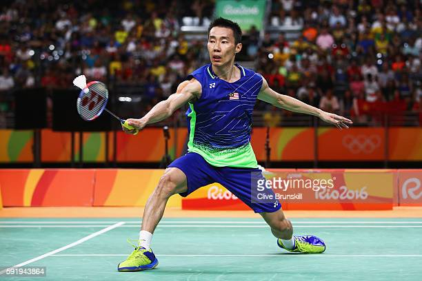 Chong Wei Lee of Malaysia competes against Dan Lin of China during the Men's Singles Badminton Semifinal against on Day 14 of the Rio 2016 Olympic...