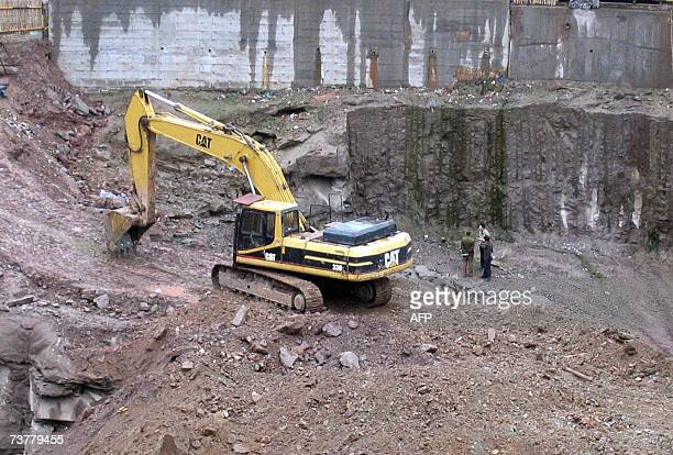 Workmen operating an excavator completely obliterated the modest brick house one of China's most recognisable buildings thanks to widely circulated...