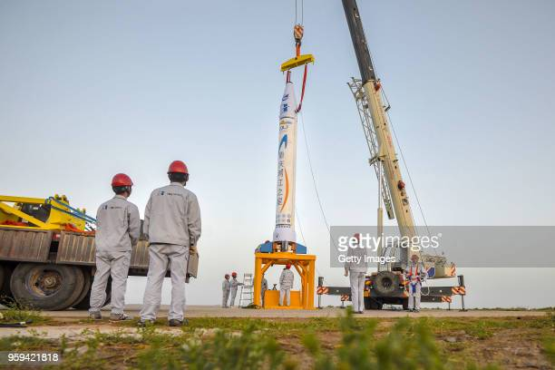 Chongqing Liangjiang Star rocket developed by China's first private rocket producer OneSpace is inspected before its maiden flight at a test field on...